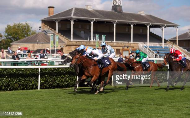 Ataser ridden by jockey Ray Dawson wins the bet365 Nursery Handicap during the St Leger Festival at Doncaster Racecourse on September 9 2020 in...