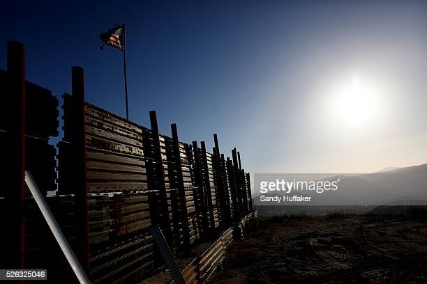 Atattered American flag flies along the USMexico border wall in Campo CA on Wednesday May 11 2011