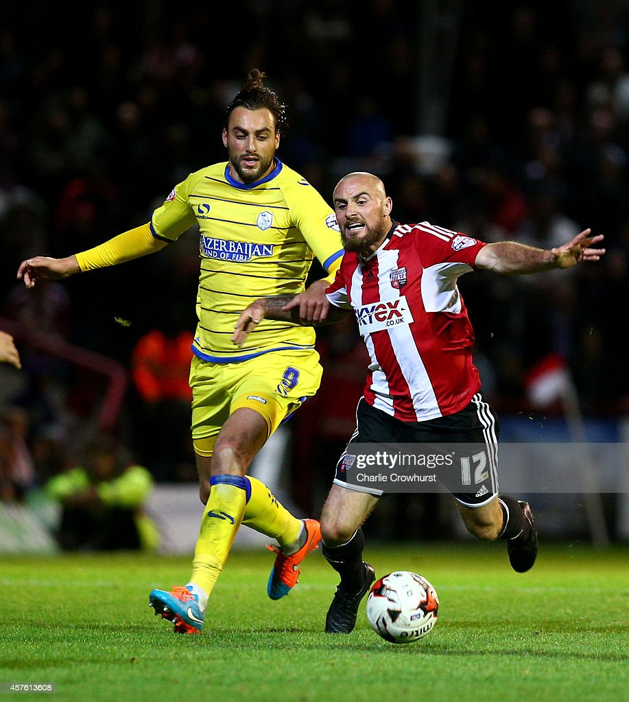 Atdhe Nihiu of Sheffield Wednesday (R) fouls Alan McCormack of Brentford during the Sky Bet Championship match between Brentford and Sheffield Wednesday at Griffin Park on October 21, 2014 in Brentford, England.