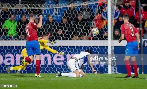 Atdhe Nuhiu of Kosovo scores the opening goal past goalkeeper Tomas Vaclik of the Czech Republic during the UEFA Euro 2020 Qualifier between Czech...