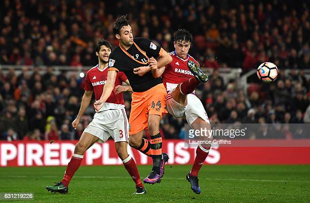 Atdhe Nuhiu of Sheffield Wednesday and Bernardo Espinosa of Middlesbrough battle for possession during The Emirates FA Cup Third Round match between...