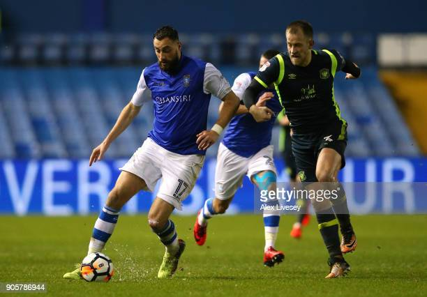 Atdhe Nuhiu of Sheffield Wednesday beats Danny Grainger of Carlisle United during the Emirates FA Cup Third Round Replay match between Sheffield...