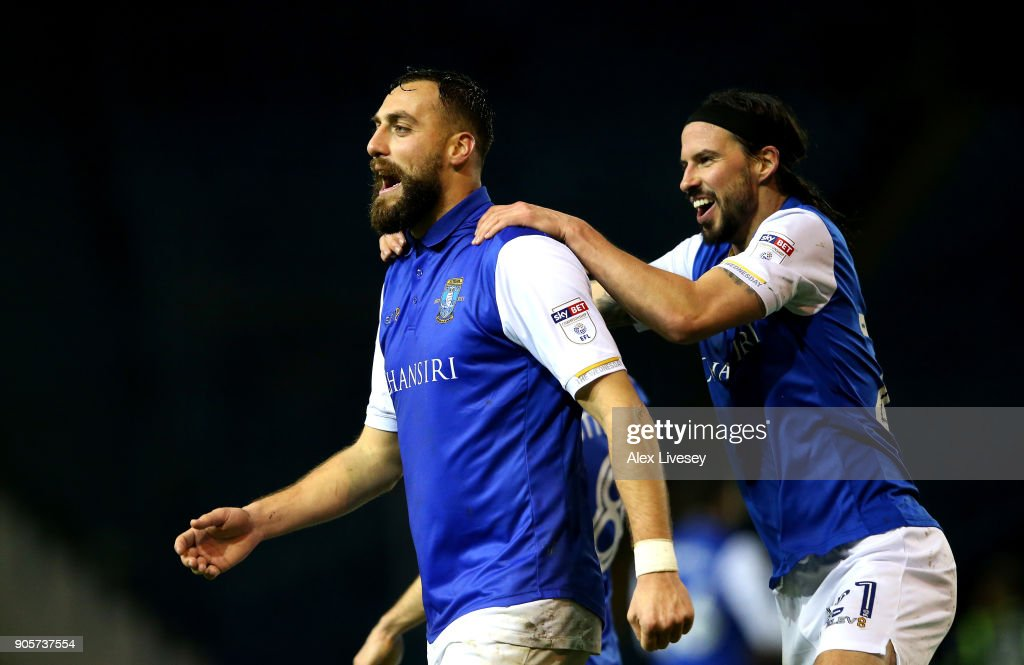 Atdhe Nuhiu of Sheffield Wednesday celebrates as he scores their second goal with George Boyd during The Emirates FA Cup Third Round Replay match between Sheffield Wednesday and Carlisle United at Hillsborough on January 16, 2018 in Sheffield, England.