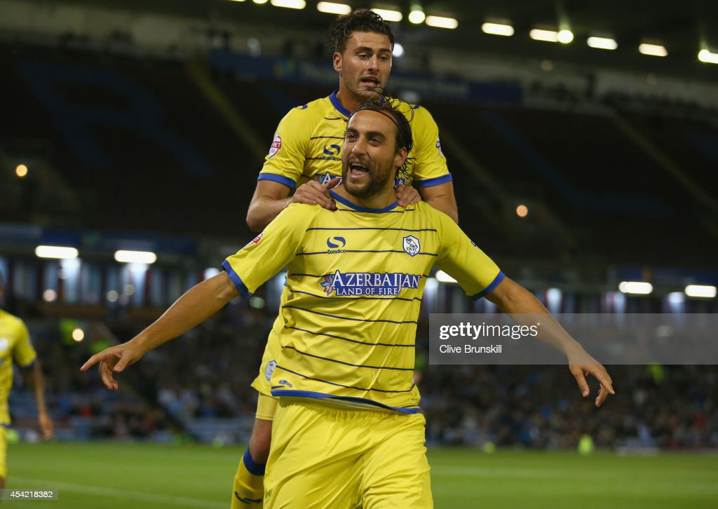Atdhe Nuhiu of Sheffield Wednesday celebrates with team mate Gary Madine after scoring his teams first goal from the penalty spot during the Capital One Cup Second Round match between Burnley and Sheffield Wednesday at Turf Moor on August 26, 2014 in Burnley, England.