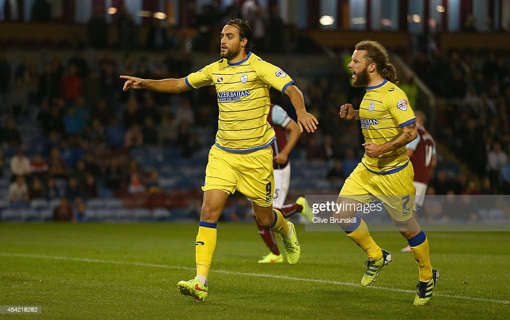 Atdhe Nuhiu of Sheffield Wednesday celebrates with team mate Stevie May after scoring his teams first goal from the penalty spot during the Capital One Cup Second Round match between Burnley and Sheffield Wednesday at Turf Moor on August 26, 2014 in Burnley, England.