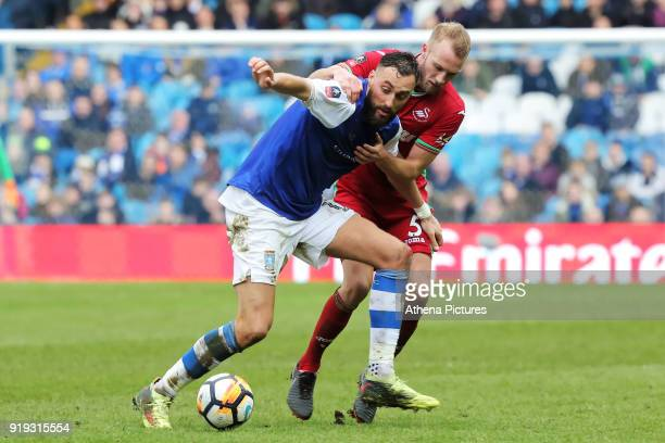 Atdhe Nuhiu of Sheffield Wednesday challenged by Mike van der Hoorn of Swansea City during The Emirates FA Cup Fifth Round match between Sheffield...