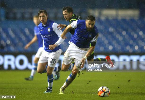 Atdhe Nuhiu of Sheffield Wednesday evades Jamie Devitt of Carlisle United during The Emirates FA Cup Third Round Replay match between Sheffield...