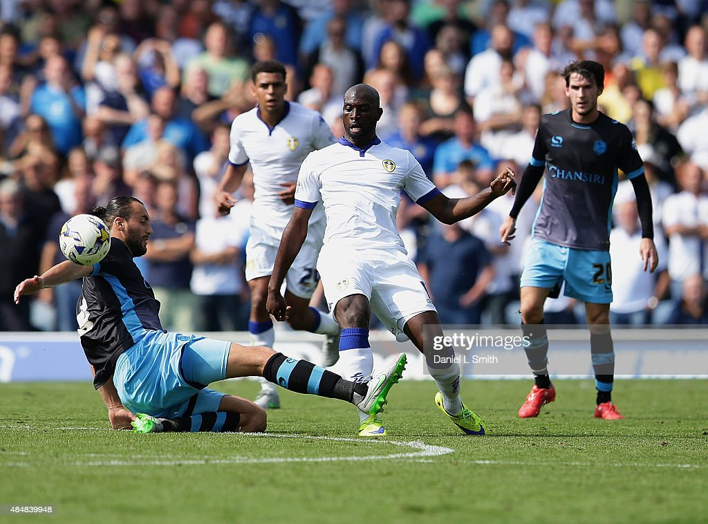 Atdhe Nuhiu of Sheffield Wednesday FC tackles Souleymane Doukara of Leeds United FC during the Sky Bet Championship match between Leeds United and Sheffield Wednesday at Elland Road on August 22, 2015 in Leeds, England.