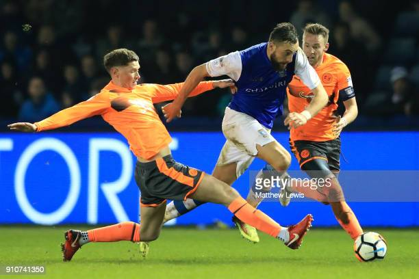 Atdhe Nuhiu of Sheffield Wednesday is tackled by Sam Smith of Reading during The Emirates FA Cup Fourth Round match between Sheffield Wednesday and...