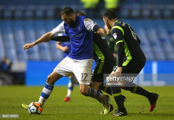 Atdhe Nuhiu of Sheffield Wednesday is watched by Tom Parkes of Carlisle United during The Emirates FA Cup Third Round Replay match between Sheffield...