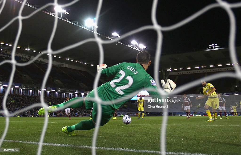 Atdhe Nuhiu of Sheffield Wednesday scores his team's first goal past Burnley keeper Matthew Gilks from the penalty spot during the Capital One Cup Second Round match between Burnley and Sheffield Wednesday at Turf Moor on August 26, 2014 in Burnley, England.