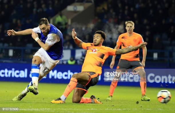 Atdhe Nuhiu of Sheffield Wednesday shoots past Liam Moore of Reading during The Emirates FA Cup Fourth Round match between Sheffield Wednesday and...