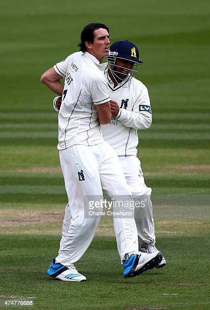 Ateeq Javid of Warwickshire celebrates with bowler Chris Wright after taking the wicket of Sussex's Luke Wells during day three of the LV County...