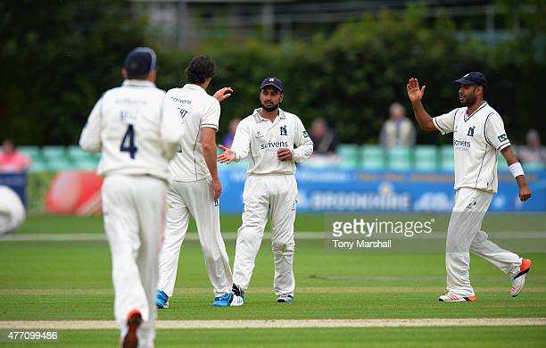 Ateeq Javid of Warwickshire celebrates with Chris Wright of Warwickshire after catching out Daryl Mitchell of Worcestershire during the LV County...