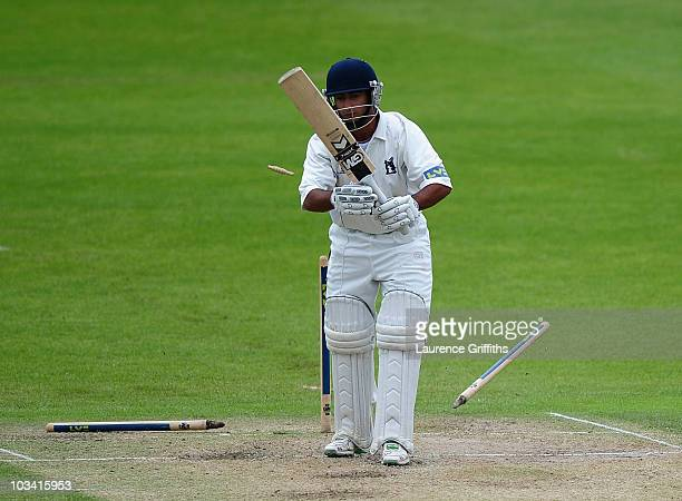 Ateeq Javid of Warwickshire has his stumps uprooted as he is bowled by Paul Franks of Nottinghamshire during the LV County Championship match between...