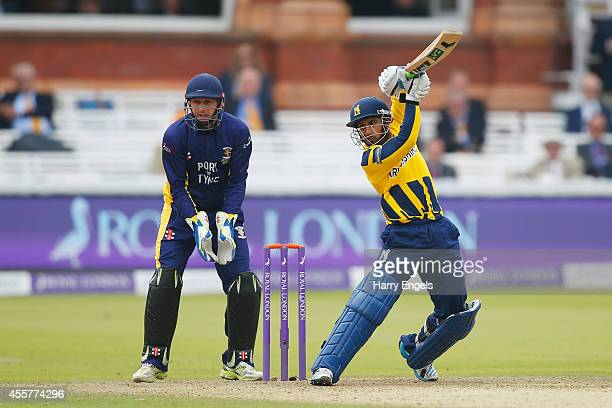 Ateeq Javid of Warwickshire hits out watched by Durham wicketkeeper Phil Mustard during the Royal London OneDay Cup Final between Warwickshire and...
