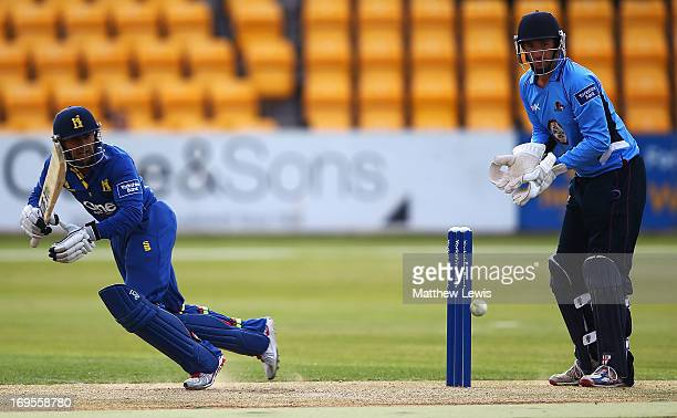 Ateeq Javid of Warwickshire hits the ball towards the boundary as David Murphy of Northamptonshire looks on during the Yorkshire Bank 40 match...