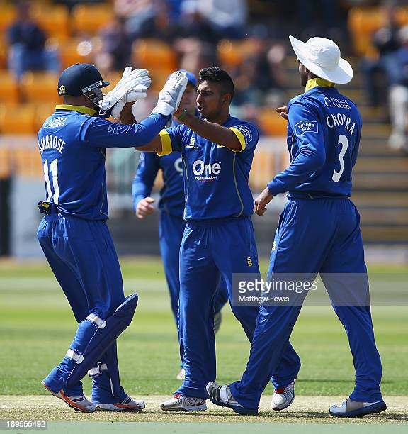 Ateeq Javid of Warwickshire is congratulated by Tim Ambrose on the wicket of Kyle Coetzer of Northamptonshire during the Yorkshire Bank 40 match...