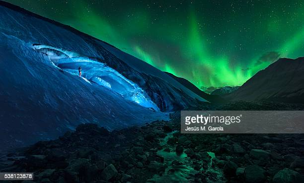 athabasca cave and northern lights - banff stock photos and pictures