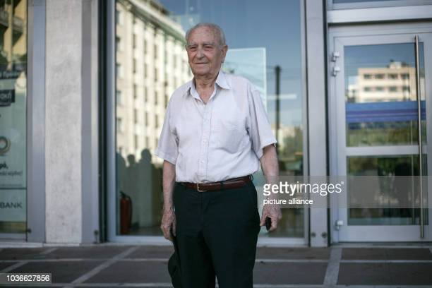 Athanasios Chasiotis in front of the Alpha Bank branch in downtown Athens Greece 20 July 2015 as Greek banks reopened following a three week closure...