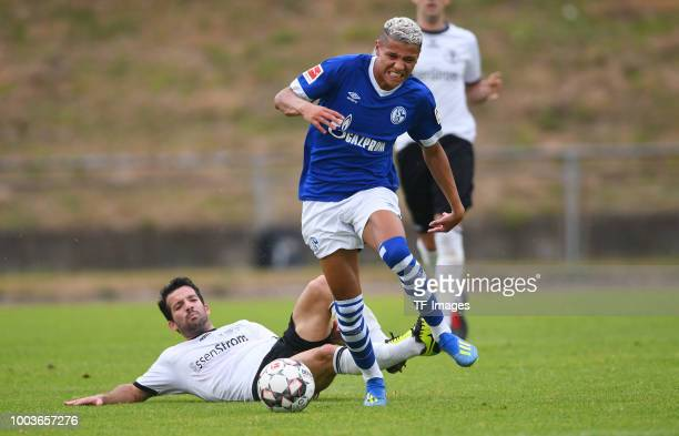 Athanasios Tsourakis of Schwarz Weiss Essen and Amine Harit of Schalke battle for the ball during the Friendly match between Schwarz Weiss Essen and...