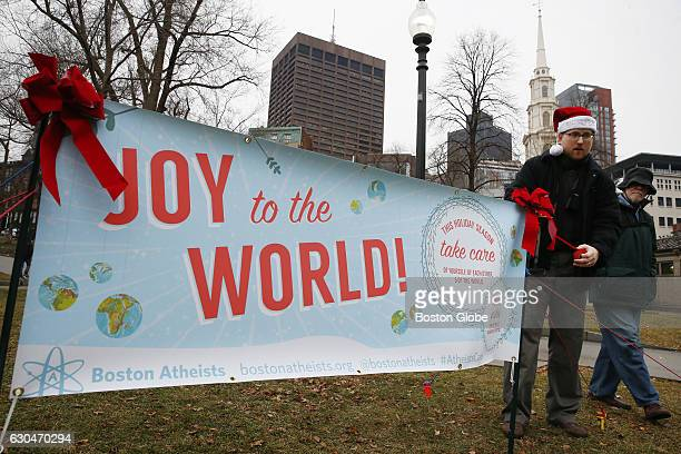 Atheist Zachary Bos of Malden helps to install a holiday banner near Park Street Station on the Boston Common in Boston on Dec 22 2016