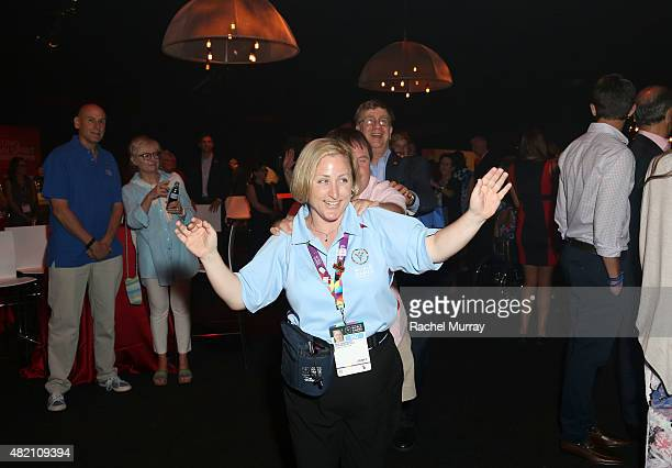 Athelete Debi Anderson leads a conga line during 'CocaCola and ESPN Celebration Of The Human Spirit Of Eunice Kennedy Shriver' at the Special...