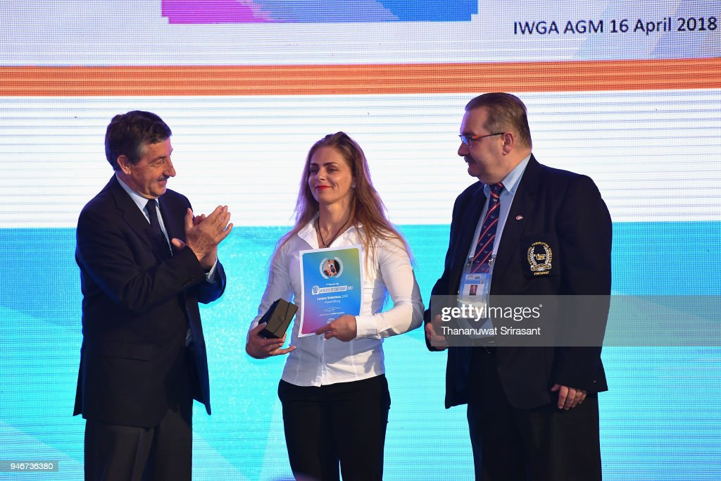 Athelete Of The Year laureate Larysa Soloviova (C) of Ukraine is applauded by the IWGA (International World Games Association) President and International Canoe Federation President Jose Perurena Lopez (L) at the ceremony during the IWGA General Annual Meeting on day two of the SportAccord at Centara Grand & Bangkok Convention Centre on April 16, 2018 in Bangkok, Thailand.