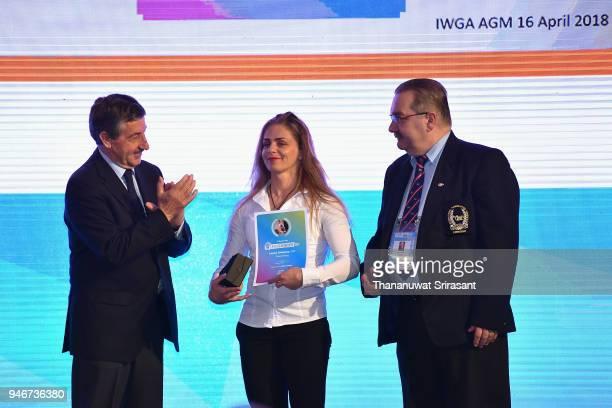 Athelete Of The Year laureate Larysa Soloviova of Ukraine is applauded by the IWGA President and International Canoe Federation President Jose...