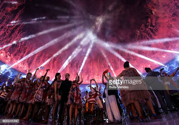 Atheletes and performers enjoy fireworks during the Opening Ceremony of the Rio 2016 Paralympic Games at Maracana Stadium on September 7 2016 in Rio...
