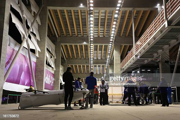 Atheletes prepare their sleds in the start house during the Women's Viessman FIBT Bob Skeleton World Cup at the Sanki Sliding Center in Krasnya...