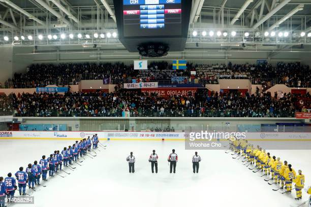 Athelets listen to Arirang instead of the National Anthem of South Korea during the Women's Ice Hockey friendly match at Seonhak International Ice...