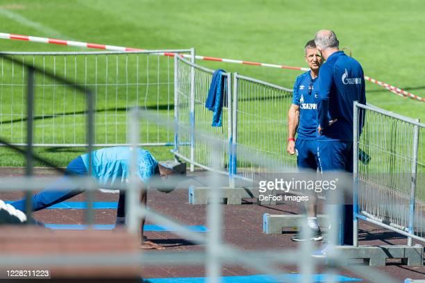 Atheltic coach Werner Leuthard of FC Schalke 04 and chief of sport Jochen Schneider of FC Schalke 04 speak during the FC Schalke 04 Training Camp on...
