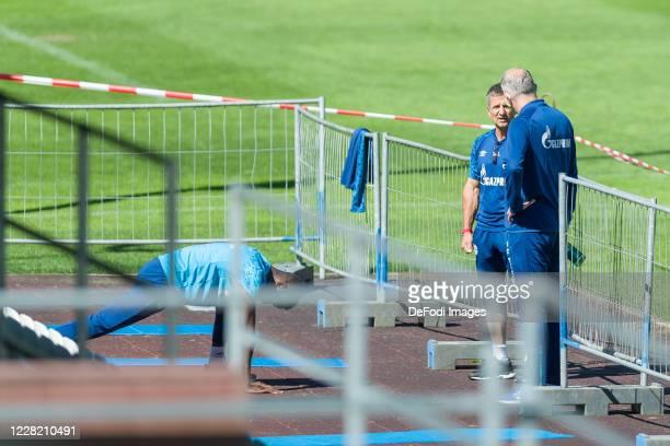Atheltic coach Werner Leuthard of FC Schalke 04 and Vorstand Sport Jochen Schneider of FC Schalke 04 speaks with during the FC Schalke 04 Training...