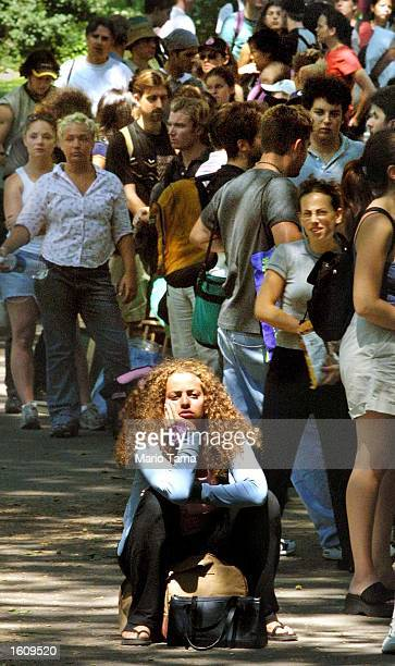 Athena Karkanis waits in line with hundreds of others for tickets to The Seagull outside Delacorte Theatre in Central Park August 16 2001 in New York...