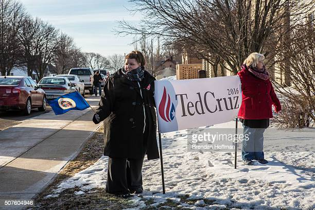Athena Perez and Melody Perez hold a sign in support of Republican presidential candidate Sen Ted Cruz at a campaign event at South Hardin Middle...