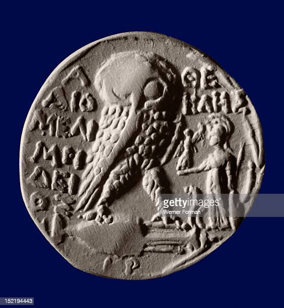 Athenian four drachma coin with the symbols of the city the owl and the statue of Athena Parthenos Greece Ancient Greek Classical period Athens