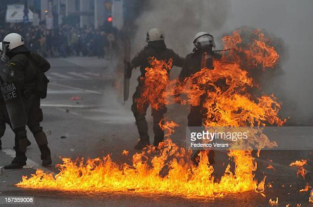 Athens 15 December 2010, A molotov cocktail explodes near riot police officers on Syntagma Square in Athens during the general strike of December 15,...