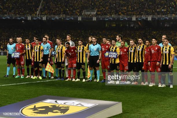 AEK Athens and Bayern Munich's players pose with referees before the UEFA Champions League football match between AEK Athens FC and FC Bayern Munchen...