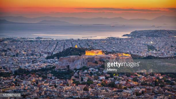athens cityscape in sunset light panorama - athens greece stock pictures, royalty-free photos & images