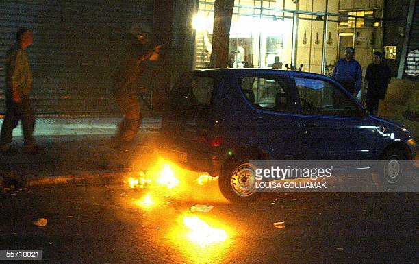 A car is hit by a molotov cocktail bomb thrown by anarchists during their demonstration against a neonazi faction gathering in central Athens 17...