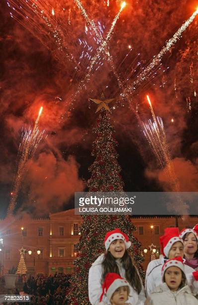 A children choir carols in front of the Athens' Christmas tree during its launching ceremony at the central city's Syntagma square 14 December 2006...