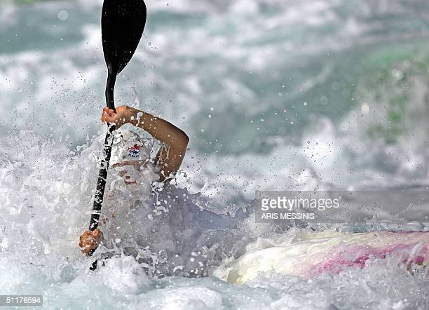 A female athlete competes in the kayak slalom singles event during a demonstration day at the Olympic Canoe/Kayak Slalom Centre in the Hellinikon...