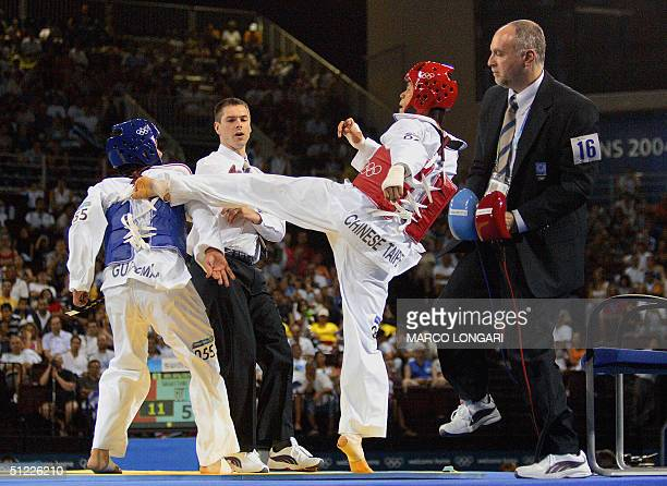 A judge moves out of the way as Huang Chih Hsiung of Taiwan and Gabriel Sagastume of Guatemala clash in their men's under 68kg semifinal taekwondo...