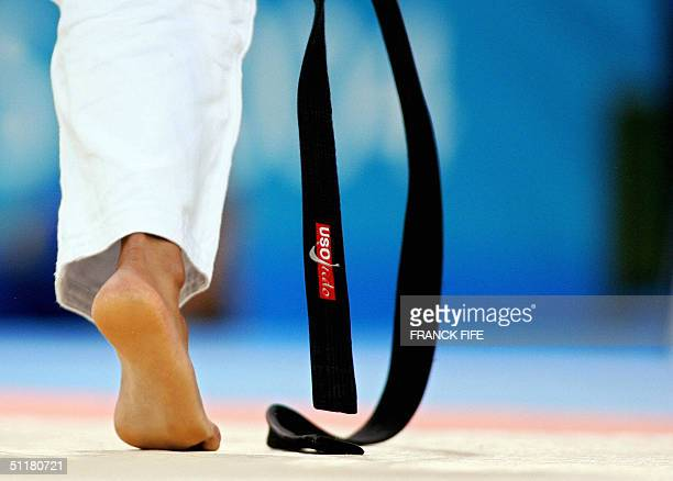 Judoka's black belt is pictured during the women under 63 kg judo competition 17 August 2004 at the Ana Liosia Olympic Hall in Athens during the 2004...