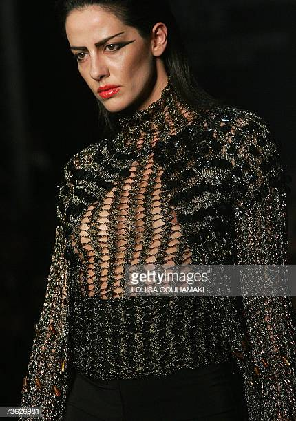 A model presents a creation by GreekCypriot designer Yiannos Xenis during the Athens Fashion Week for autumnwinter 200708 at Zappion hall late 18...