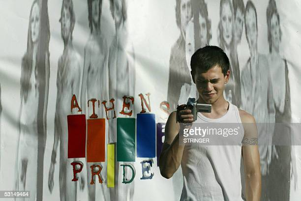 A participant holds a camera before the first gay parade in Athens for the celebrations of Gay Pride Day 25 June 2005 AFP PHOTO /STRINGER