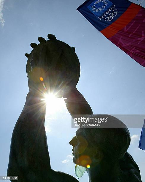 Picture taken 08 August 2004 at the Olympic Village in Athens shows a statue representing a discus thrower, five days before the beginning of the...