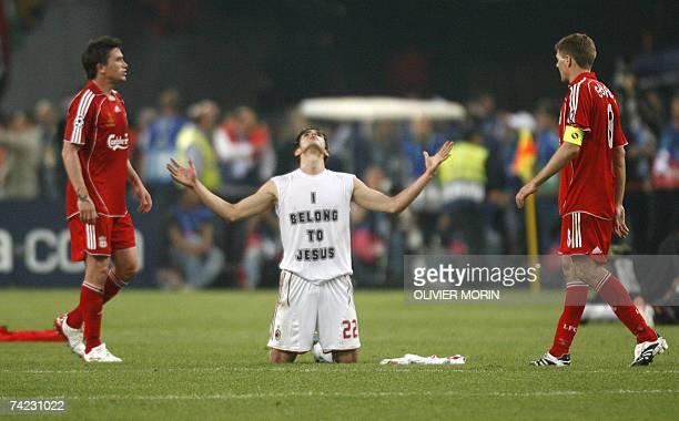 AC Milan's Brazilian midfielder Kaka celebrates in front of Liverpool's midfielder Steven Gerrard after winning the Champions League football final...