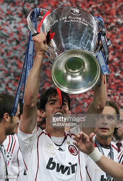 AC Milan's Brazilian midfielder Kaka holds the trophy after winning the Champions League final football match against Liverpool at the Olympic...